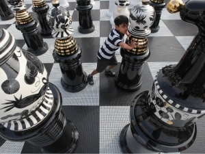 A boy moves a giant chess piece on a board in London's Trafalgar Square. (Dan Kitwood/Getty Images)